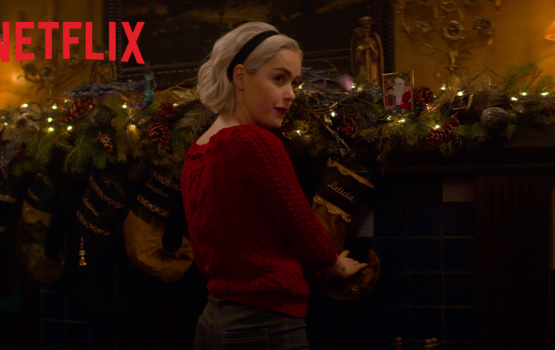 "WATCH: new ""Sabrina"" Christmas special trailer has devils, Christmas sweaters, and seances"