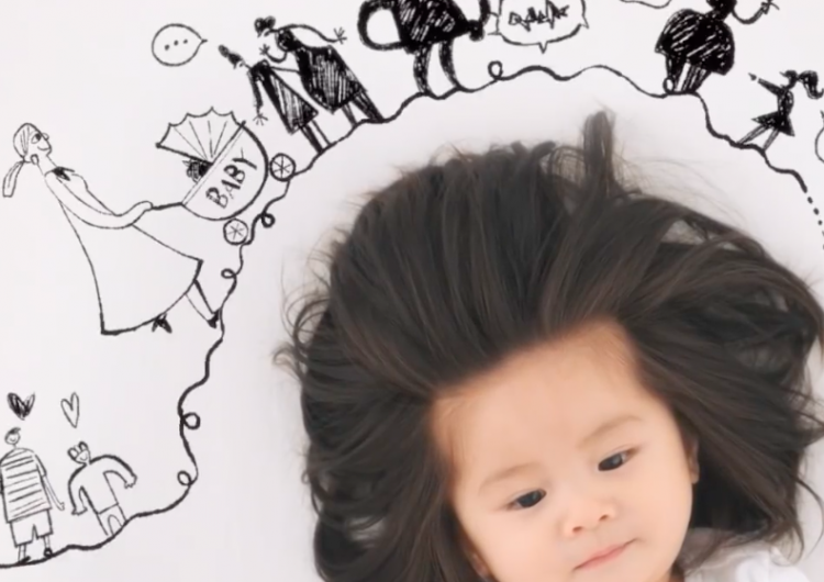 This baby's glorious head of hair earned her a Pantene ad
