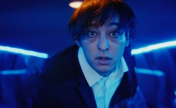 Joji literally runs from fame in his new music video