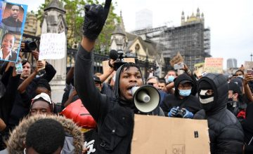 John Boyega proves he's a hero IRL too at this #BlackLivesMatter protest