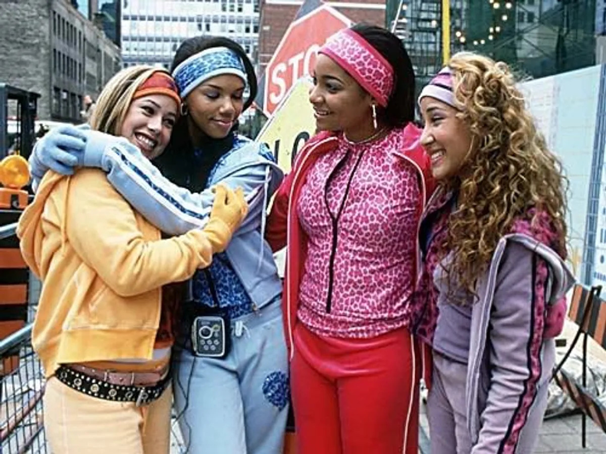 The Cheetah Girls wearing colorful tracksuits