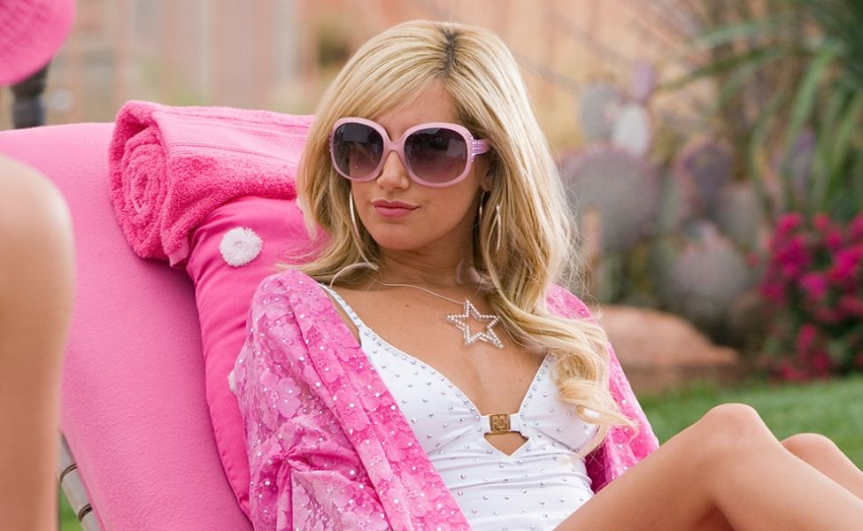 Sharpay Evans sitting beside a pool