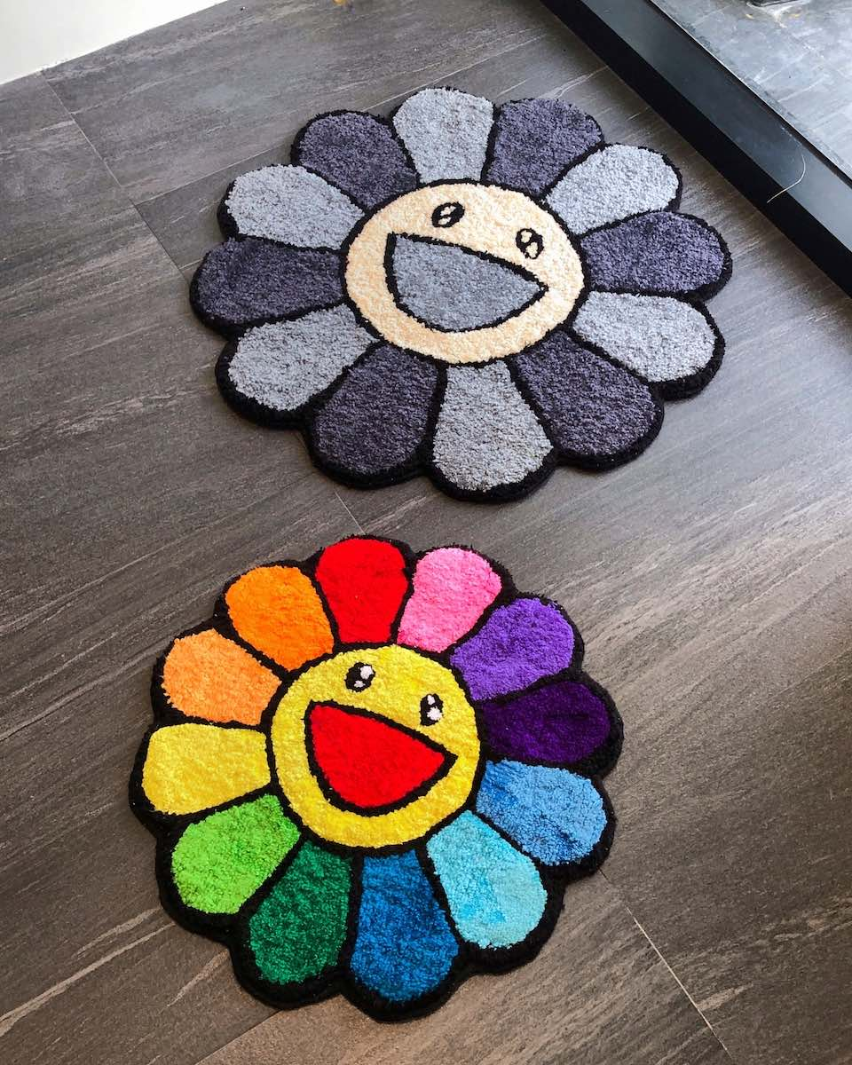 Two flower design rugs, with one colorful and the other monochromatic