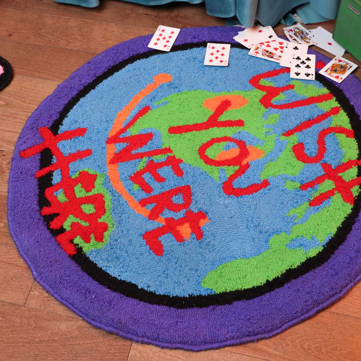 """A rug that says """"Wish You Were Here"""""""