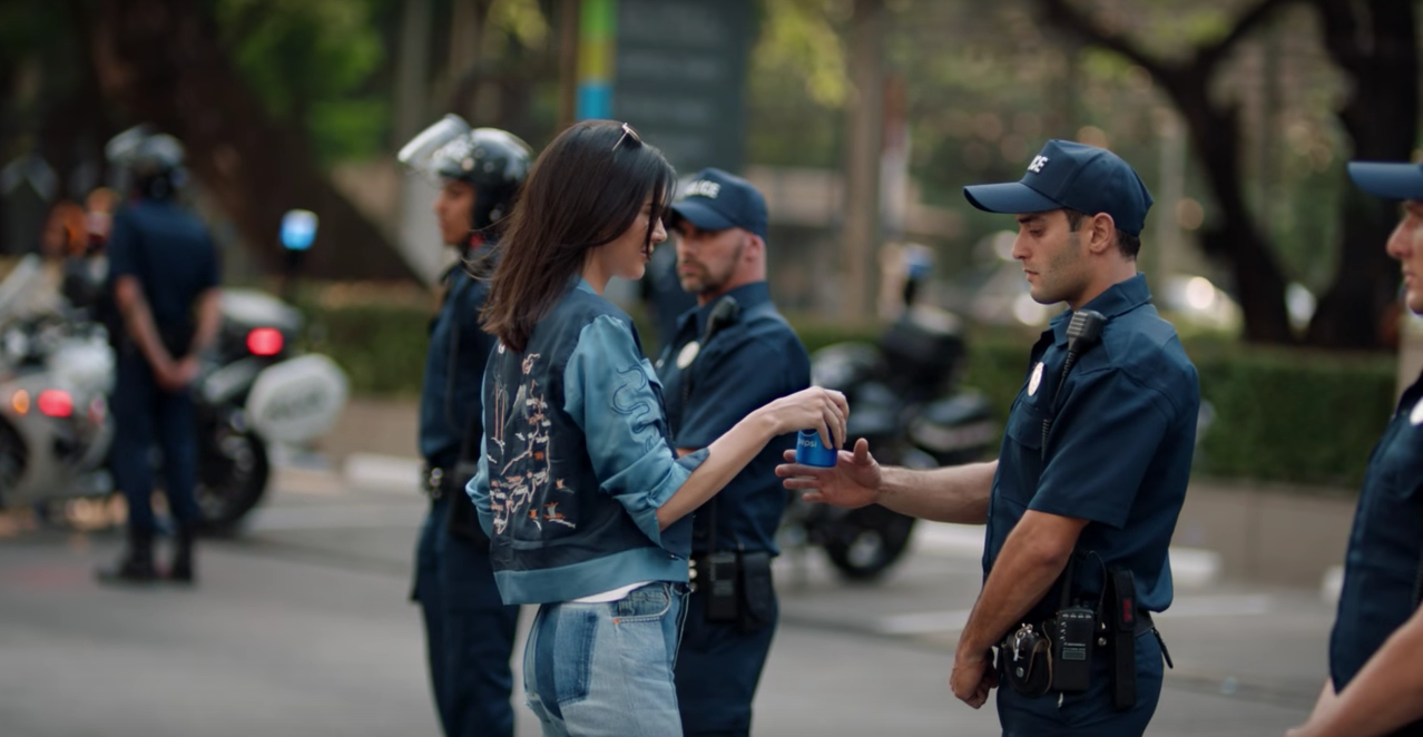 We wish solving issues was as easy as Kendall Jenner giving police a can of Pepsi