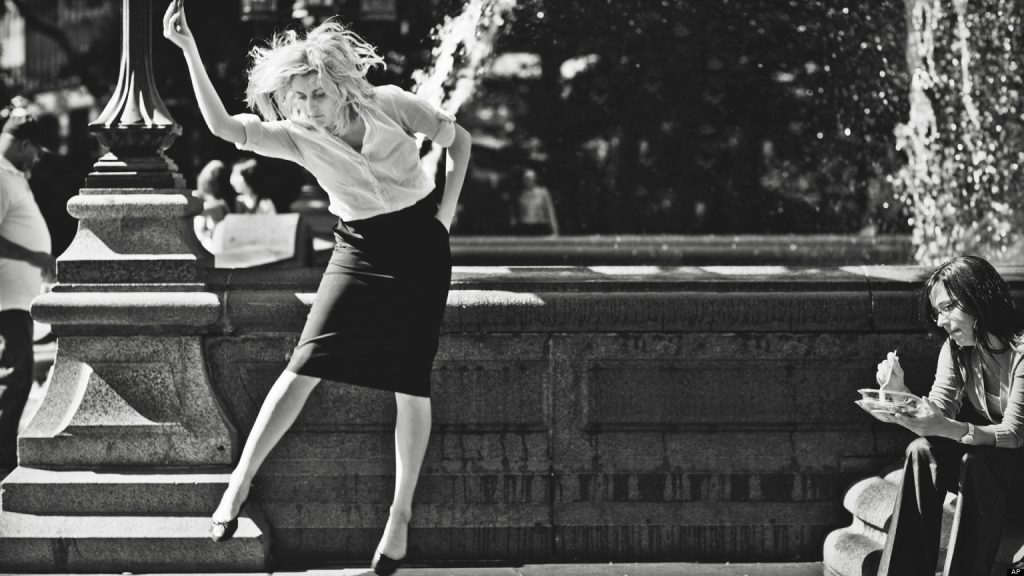 """This undated publicity photo released by the Independent Film Channel shows Greta Gerwig, left, as Frances dancing in front of fountain in a scene from the film, """"Frances Ha."""" (AP Photo/IFC)"""